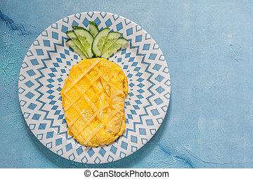 Breakfast for kids - omelette look like pineapple
