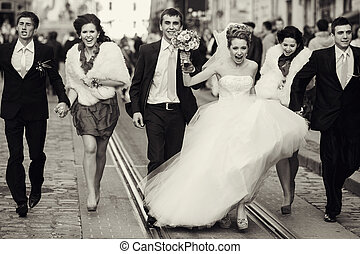 Funny bride walks in the head of a wedding procession