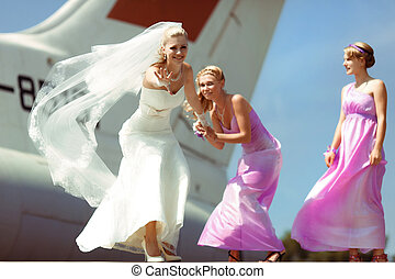 Funny bride with the two bridesmaids
