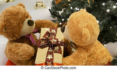 Funny brown moving teddy bears that hold a box with a gift...