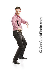 Funny business man is posing in studio with bow tie and...