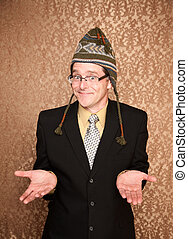 Funny Businessman in Knit Cap Shrugging