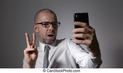 Funny businessman manager makes selfie phone.