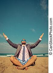 Funny businessman on the beach