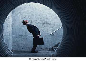 Funny Businessman side view in a tunnel