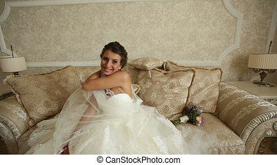 Funny Cheerful Bride - bride sits on the couch and waving...
