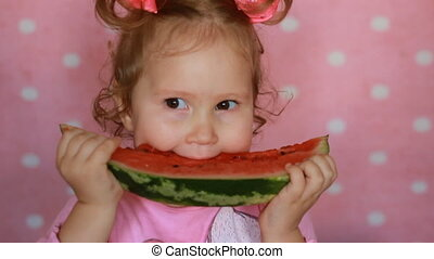 Funny cheerful happy little girl holding a piece of...