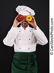 Funny chef covering his eyes of paprika