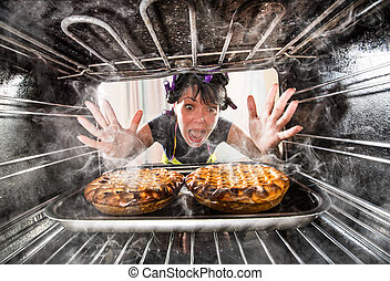 Funny Housewife overlooked cakes in the oven, so she had scorched, view from the inside of the oven. Housewife perplexed and angry. Loser is destiny!