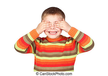 Funny child covering his eyes