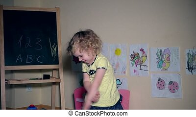 funny child girl having fun and dancing at home. recreation and entertainment