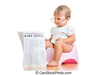 funny child girl reading newspaper on chamberpot