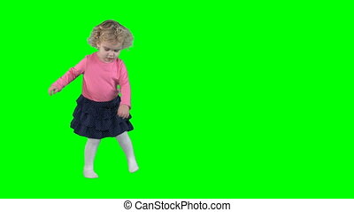 Funny child girl turn around isolated on green even chroma...