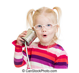 Funny child in eyeglasses using a can as a telephone...