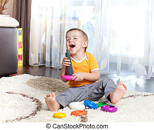 funny child playing with color toy indoor - funny child...