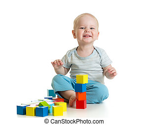 Funny child playing wooden toy blocks isolated on white