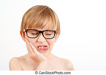 Funny child wearing glasses on white background. Happy childhood. Nerd little boy showing tongue.
