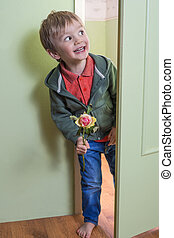 Funny child with a flower