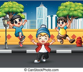 Funny children jumping and laughing on the sidewalk