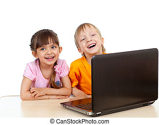 Funny children using a laptop over white background