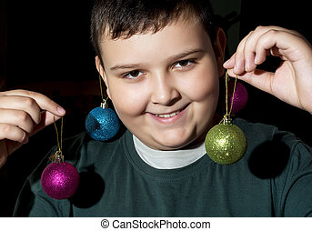 Funny christmas boy with decorative balls