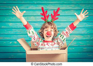 Funny Christmas reindeer in cardboard box