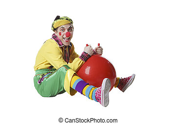 Funny clown with ball