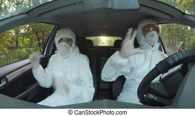 Funny concept of two young hazmat scientists workers in car...