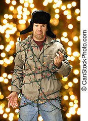 Christmas lights - Funny confused man wrapped in colorful...