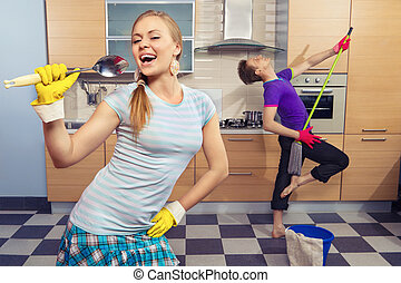Funny couple on kitchen - Modern kitchen - woman pretend to ...