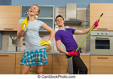 Funny couple on kitchen