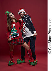 Funny couple posing in nerd clothes