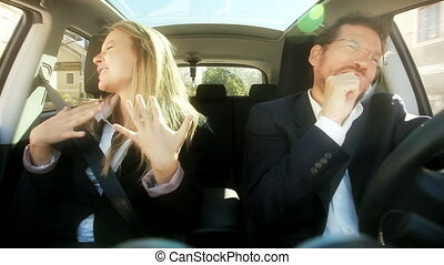 Funny couple singing in car