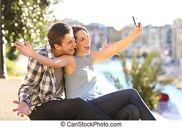 Funny couple taking selfies on vacation