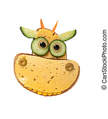 Funny cow made of bread and cheese on white background
