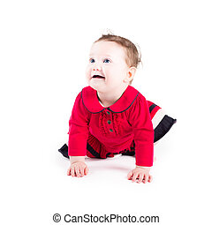 Funny crawling baby girl in a red dress