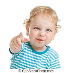 funny curly child with dirty lips pointing by finger ...