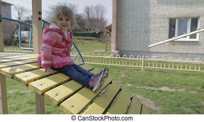 Funny cute girl is playing. Joyous female child having fun...