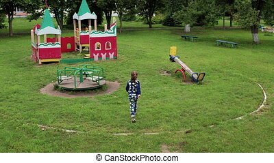 Funny cute girl is playing on schoolyard. Joyous female...