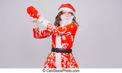 Funny dancing Christmas girl with red fluffy Santa Hat