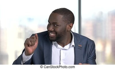 Funny dark-skinned man in formal wear. Cheerful black man in...