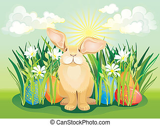 Funny Easter bunny in the grass wit