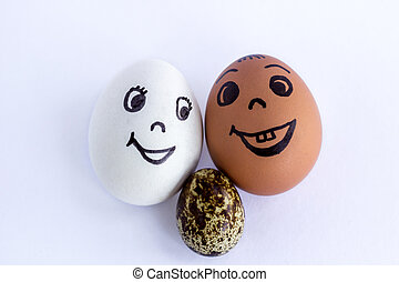 Funny eggs imitating a happy mixed couple with multicolored baby