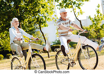 Funny elderly people enjoying active vacation