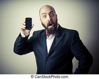 funny elegant bearded man showing phone