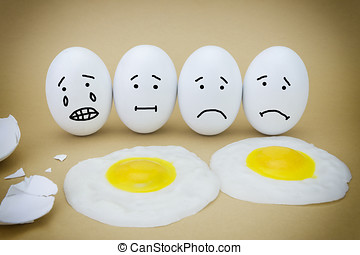 Funny emotional eggs crying and laughing in the box with...