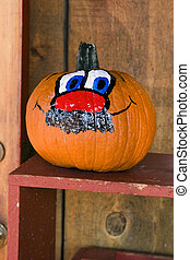 Funny face painted on pumpkin