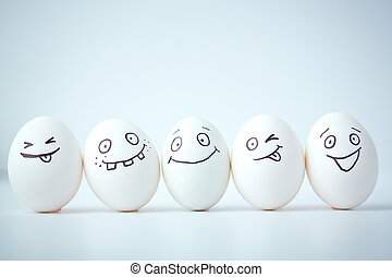 Funny faces - Line of eggs with different facial expressions