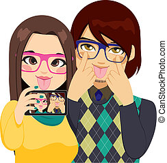 Funny Faces Selfie - Young couple making funny faces taking...