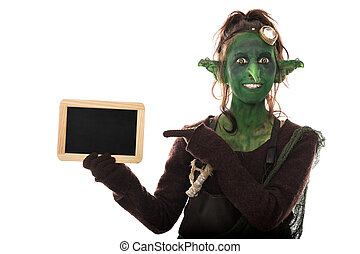 funny female goblin pointing to a slate, copyspace